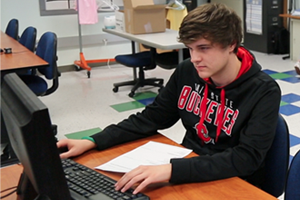 Timberland Student Works on Computer
